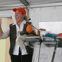 Dona speaking at a presentation